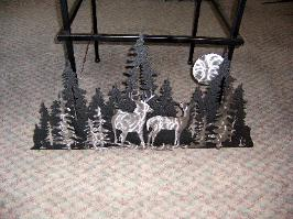 Deer wall art, metal deer scene.