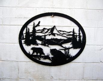 Metal wall art bear scene.